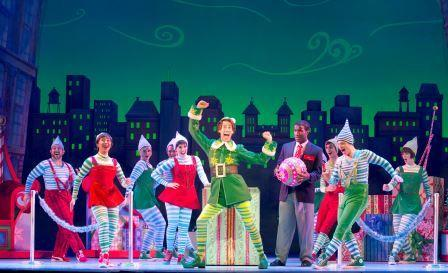 "Matt Kopec (Buddy) and the cast of ""Elf The Musical."" Photo by Joan Marcus"