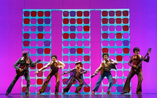 Reed L Shannon as Michael Jackson (center) with the Jackson 5 in a scene from MoTOWN THE MUSICAL First National Tour (c) Joan Marcus, 2014