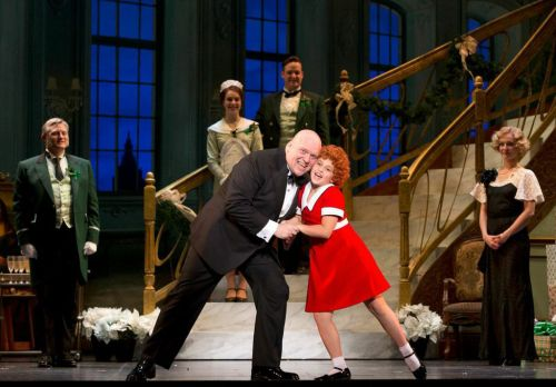 "Gilgamesh Taggett as Oliver Warbucks and Issie Swickle as Annie in ""I Don't Need  Anything But You."" Photo by Joan Marcus"